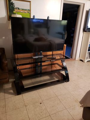 Phillips 55 inch with glass stand and wall mount for Sale in Revere, MA