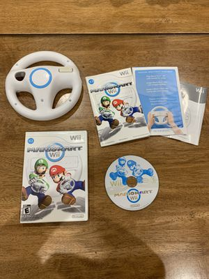 Mario Kart Wii Complete With Booklet And Wheel (Nintendo Wii) for Sale in Fremont, CA