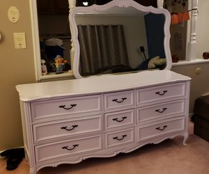 Long dresser with adjustable mirror..solid for Sale in Bristol, PA