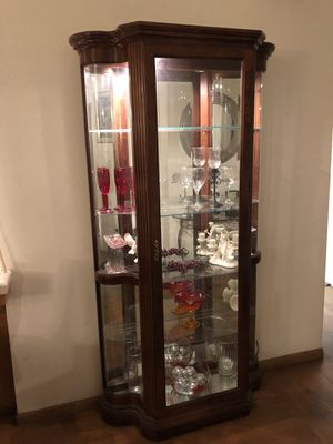 Nice cherry wood curio removable glass shelving mirror background with lighting inside for Sale in Fresno, CA