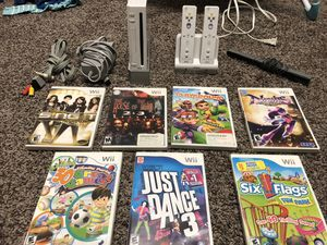 Wii console, controllers, charging dock, and 7 games for Sale in Suwanee, GA