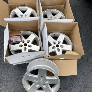 5 Jeep Wrangler rims, along with 2 gently used tires for Sale in Jackson Township, NJ