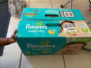 Size 2 pampers and a box of wipes for Sale in Las Vegas, NV