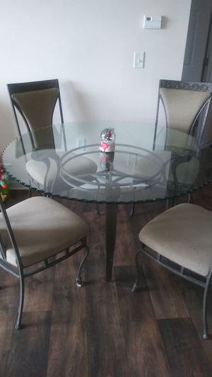 Glass round dining table with four chairs for Sale in Sterling, VA