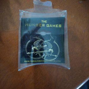 The Hunger Games hoop earrings for Sale in Chester, VA