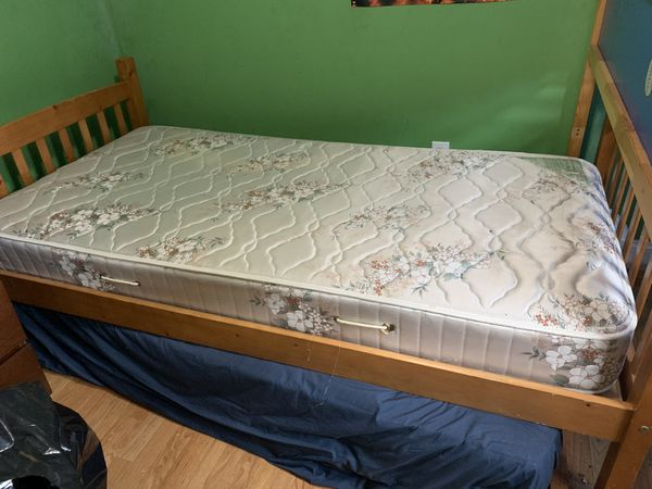 Twin size bed with trundle bed