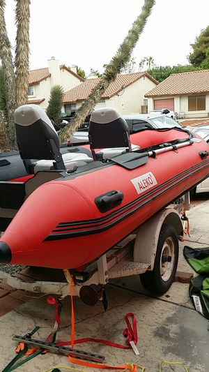 Inflatable boat 14' aluminum floor,with trailer and 20hp mercury for Sale in Henderson, NV