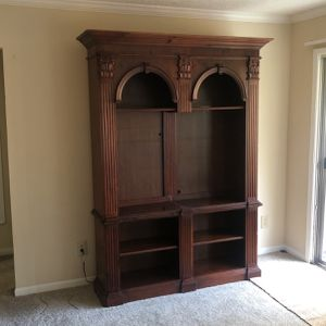 Free Bookshelf Converted to entertainment center for Sale in Smyrna, GA