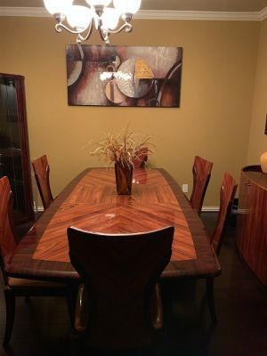 Like brand new dining room table and chairs and Hutch and bar for Sale in Houston, TX