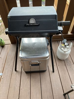 Ports-chef grill- legs removed it has two straps that hold the legs and becomes portable. Automatic ignition needs replaced but can be ignited with m for Sale in Harrisburg, PA