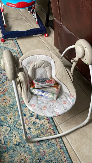 Baby swing + car seat mirror + book for Sale in Wesley Chapel, FL