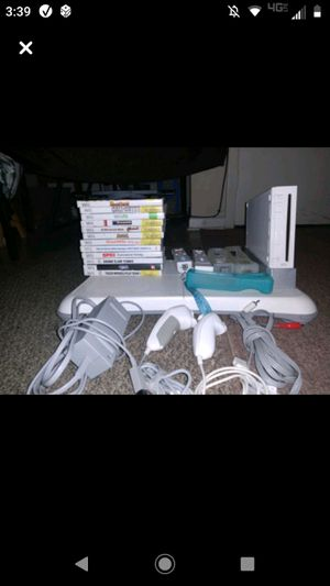 Nintendo WII, fit pad,2 controllers games and accessories for Sale in Graham, NC