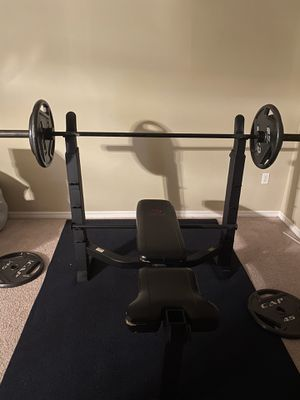 Olympic style weight bench with bar and weights for Sale in Orlando, FL