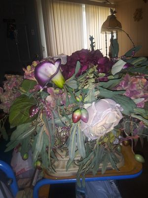 The flower arrangements is very pretty the flower pot is gorgeous as you could see by the photo for Sale in Sterling Heights, MI