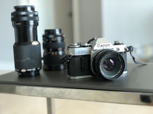 Canon AE-1 Film cam + 3 Canon lenses for Sale in Orlando, FL