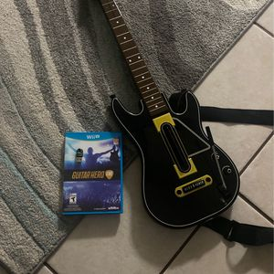 Wii U Game And Guiter for Sale in Katy, TX