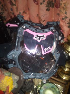 Fox women's dirt bike riding gear with helmet and chest protector for Sale in Granite City, IL