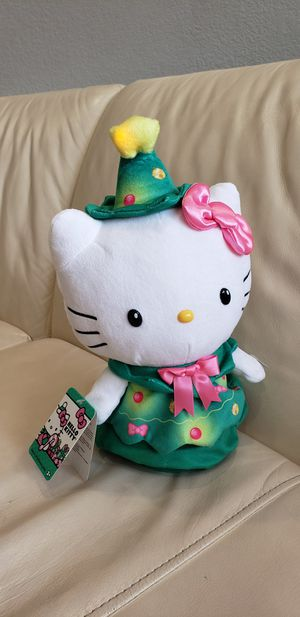 Hello Kitty Sanrio musical light up spinning tree stuffed animal. Wearing a christmas hat and a christmas tree dress for Sale in Ontario, CA