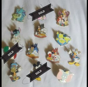 Disney trading pins 8.00 each pick up on ashlan and peach for Sale in Fresno, CA