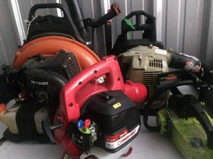Table full of power tools blowers chain saw and more for Sale in Columbus, OH