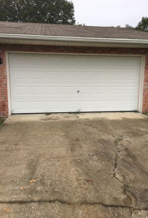 Double car garage door with all rollers and frame for Sale in Orlando, FL