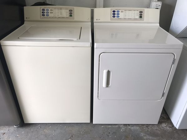GE almond color set of washer and dryer heavy duty capacity in excellent condition plus 6 months warranty. Delivery service available . Hablamos espa