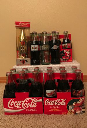 26 Coca cola collectable bottles. Including gold plated 68/1000 Olympic, cabbage patch kids, Superbowl, Christmas. for Sale in Kent, WA
