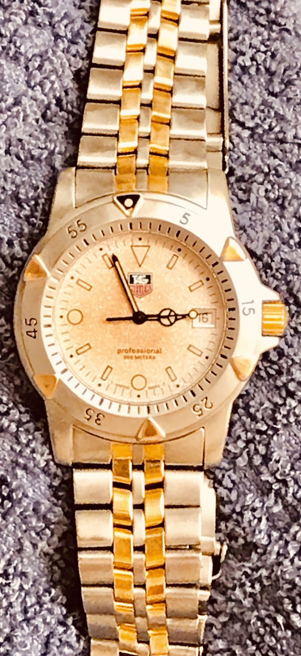 "Tag Heuer ""Professional"" DIVERS' watch, gold and stainless steel."