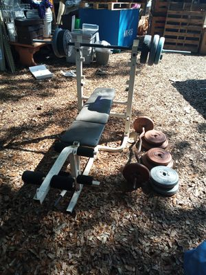 Weight bench with curl bar and weights for Sale in Kissimmee, FL