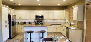 Martinez wood Refinishing kitchen cabinets any color stain paint repair we can do countertop quartz granite marble floor tile vinyl laminate wood st for Sale in Montclair, CA