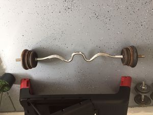 EZ Curved Barbell & Weights. Standard curl barbell with twist lock end clamps. for Sale in Glendale, AZ