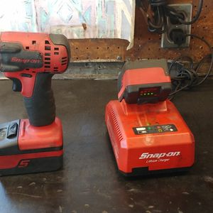 Snap-on 3/8 Electric Impact 2 Batteries And Charger for Sale in Auburn, WA
