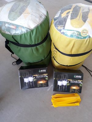 Camping deal, 2 sleeping bags, 4 new popup lanterns, 8 tent stakes for Sale in Queen Creek, AZ