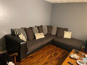 L Shape black leather bottom cloth cushions with pillows for Sale in New Britain, CT