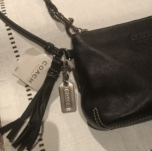 NWT $98 Coach Black Leatherware zip big wristlet with tassel for Sale in Pittsburgh, PA