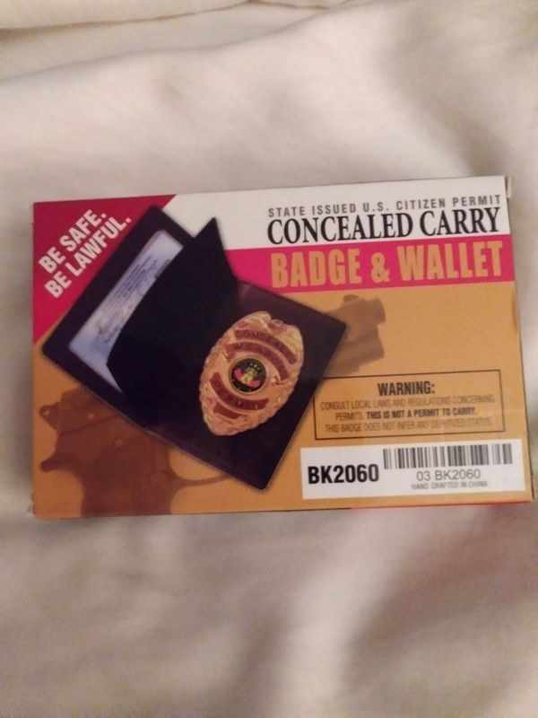 Concealed carry Badge & wallet. Never used.