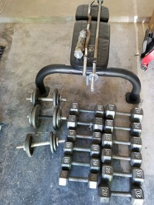 Marcy adjustable bench with 45lb bar/35 lu curling bar plus 345 lbs of dumbells for Sale in Humble, TX