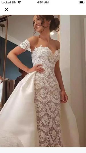Wedding dress size 10 brand new. Have some modifications from original pix for Sale in Orlando, FL