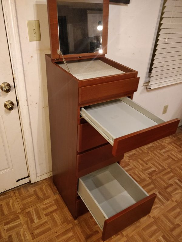 "Nice tall dresser with 6 drawers and mirror in great condition, all drawers sliding smoothly. L16""*W19""*H48.5"""