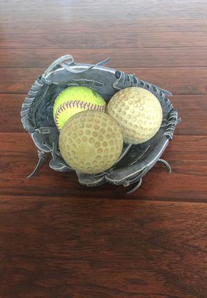 Softball glove and three Softball balls for Sale in Davis, CA