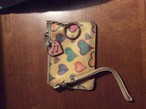 $7 only Original authentic Dooney & Bourke heart zippered wallet with strap & pink metal zipper pull used, worn, beat up only $7 for Sale in Temecula, CA