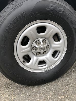 """Four Tires and 16"""" wheels from Nissan Xterra for Sale in Arlington, VA"""