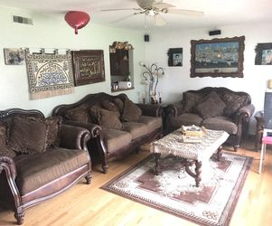 Ashley furniture Safari love and chair with end coffee table & sofa table & carpet for Sale in Moline,  IL