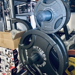 BRAND NEW OLYMPIC 2 INCH WEIGHT PLATES for Sale in Fort Lauderdale, FL