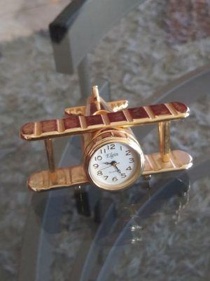 Farming.ELGIN mini clock.( PLANE ) gold tone quartz.nice!! for Sale in National City, CA