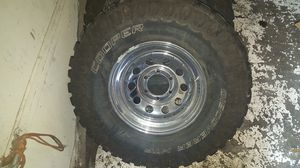 """Set of (4) Newer 33"""" Tires and 5 Lug Rims for Sale in Portland, OR"""