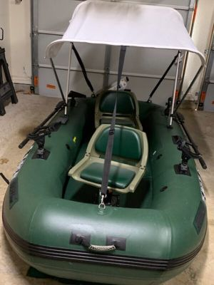 Inflatable boat/raft brand new with lots of accessories, motor, electric trolling motor and high end marine battery for Sale in Houston, TX