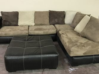 Nice used sectional with market stain on long cushion Ottoman included for Sale in Phoenix,  AZ