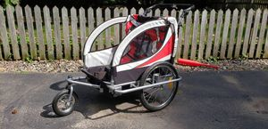 2 kid bike trailer. Works as a bike trailer or stroller. It is like new, nothing is wrong with it. It does not break down smaller for storage. Origin for Sale in Oak Grove, MN