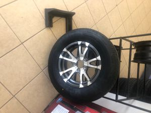 """Trailer tire and rim. 15"""" 5 lug. 205/75/15 Radial. Warranty. for Sale in Plant City, FL"""